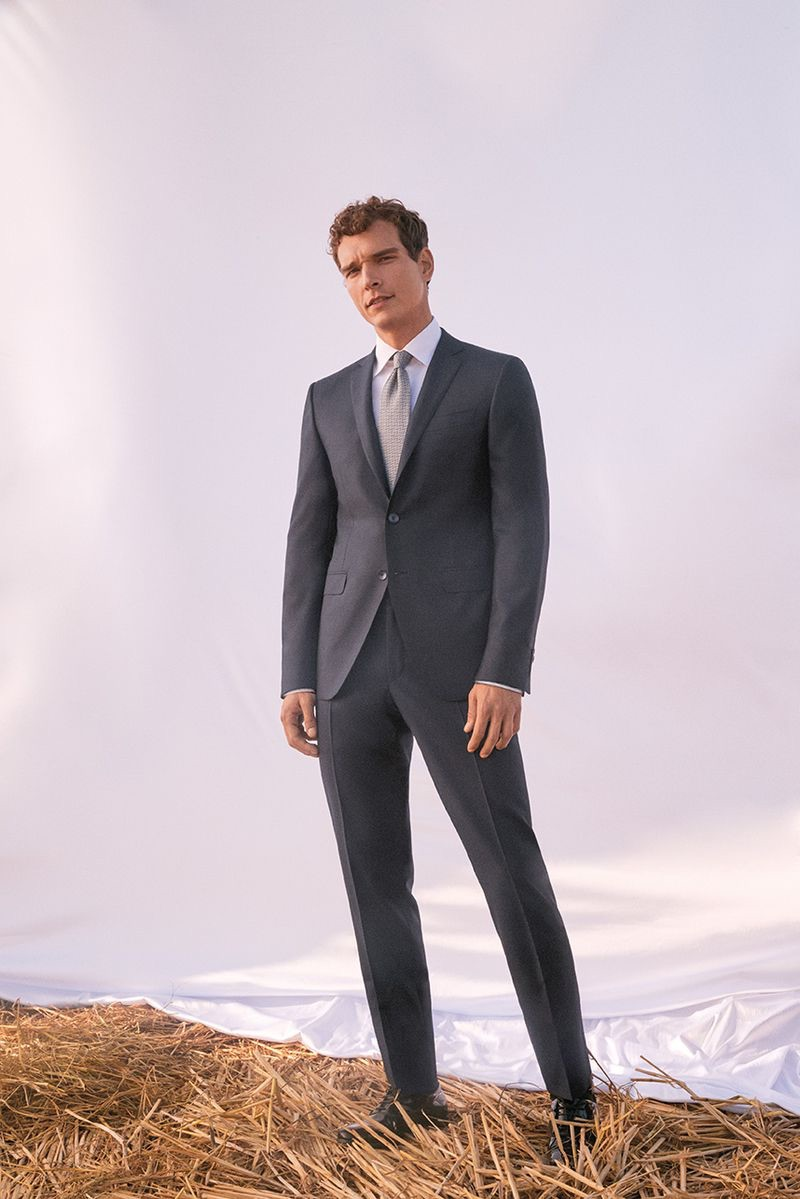 Alexandre Cunha sports a grey suit from Canali's spring-summer 2019 wedding collection.