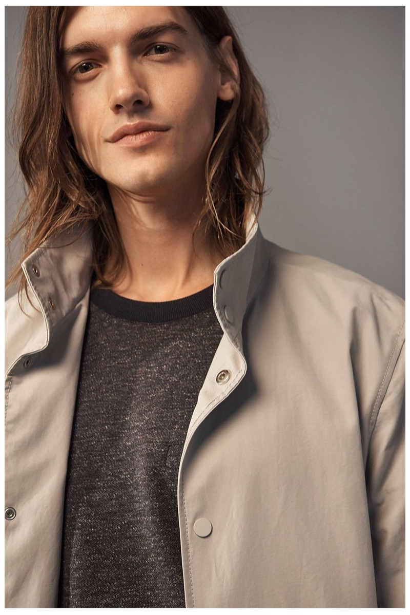 Ready for his close-up, Christian Plauche dons a Club Monaco lightweight mac jacket and twill pullover.