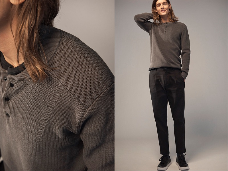 All smiles, Christian Plauche dons a Club Monaco henley sweater, pleated chinos, and leather sneakers.