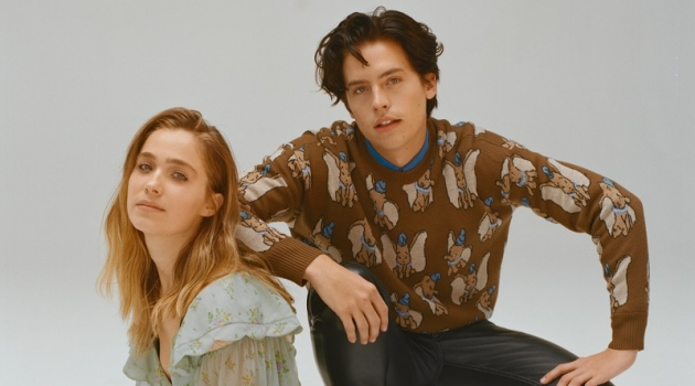 Sporting a Coach Dumbo sweater, Cole Sprouse appears in a photo shoot with Haley Lu Richardson.