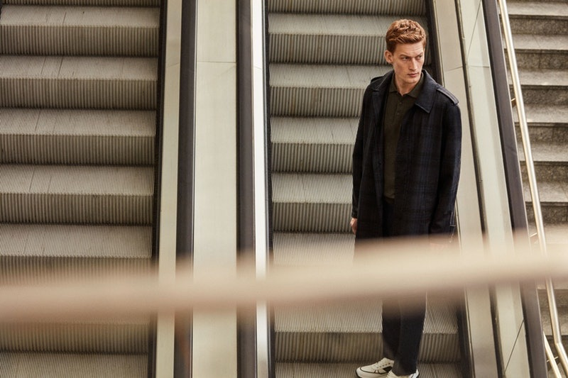 Riding the escalator, Bastian Thiery models a spring-summer 2019 look from Corneliani.