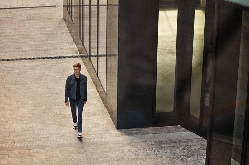 Under surveillance, Bastian Thiery wears Corneliani.