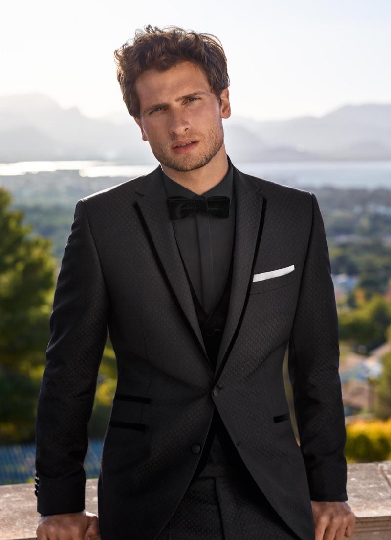 British model Tom Warren is dashing in a tuxedo look for Digel Ceremony.