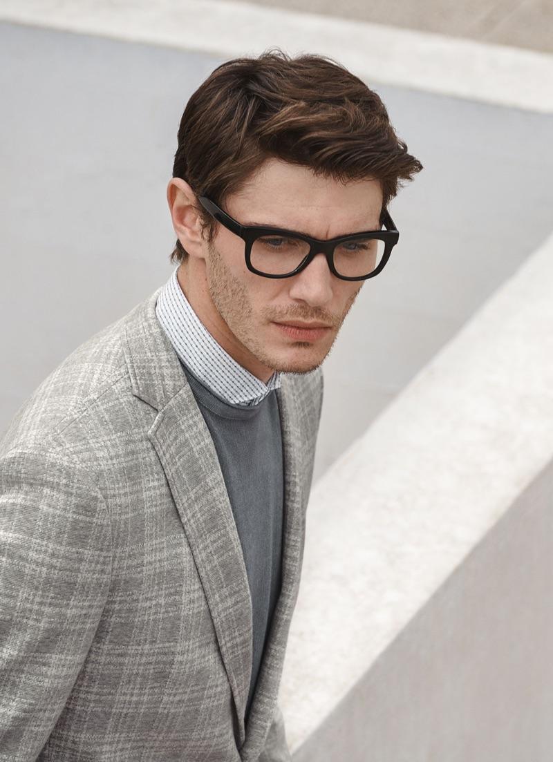 Donning black framed glasses, Julien Sabaud wears a look from Digel.