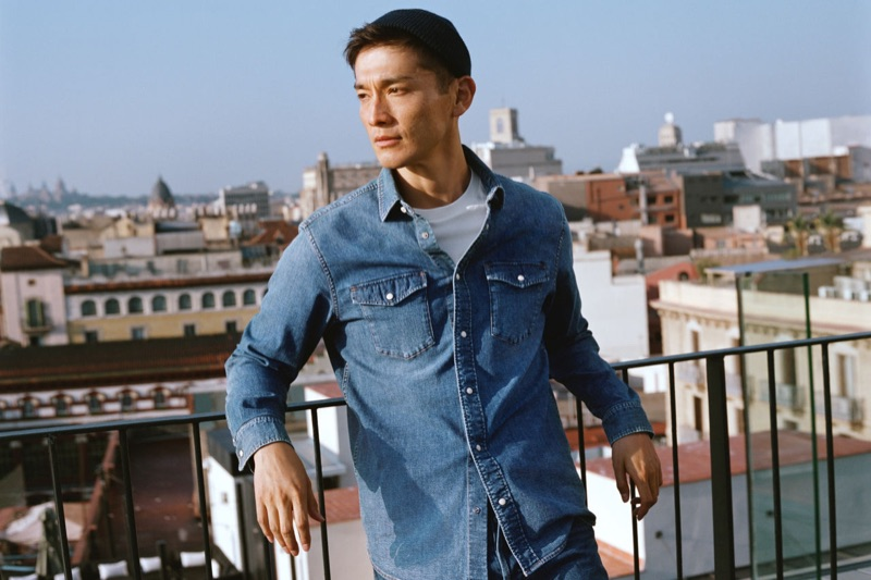 Connecting with H&M, Daisuke Ueda sports a denim shirt.