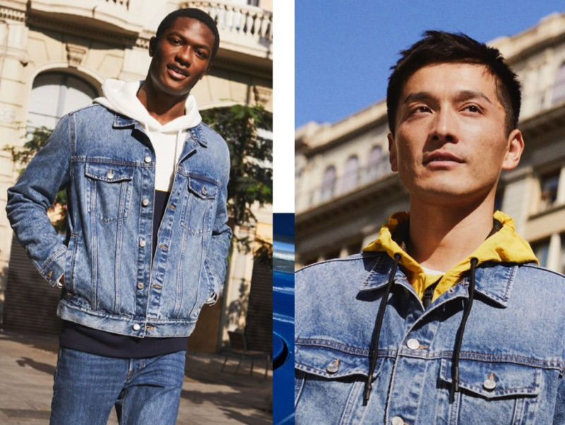 Model Hamid Onifade and Daisuke Ueda layer with H&M's denim jacket. Hamid also sports the brand's slim straight jeans.