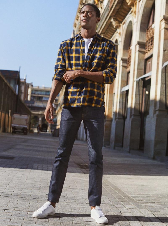 Hamid Onifade rocks slim jeans by H&M.
