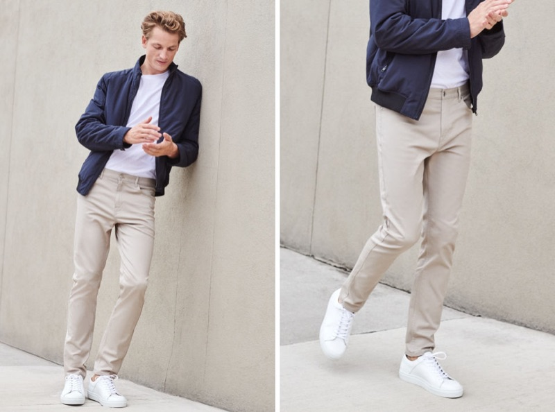 Embracing relaxed everyday style, Hugo Sauzay dons H&M's 5-pocket slim chino pants with a lightweight jacket, white sneakers, and t-shirt.