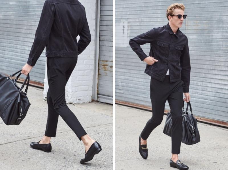On the move, Hugo Sauzay dons skinny slacks with a black denim jacket.