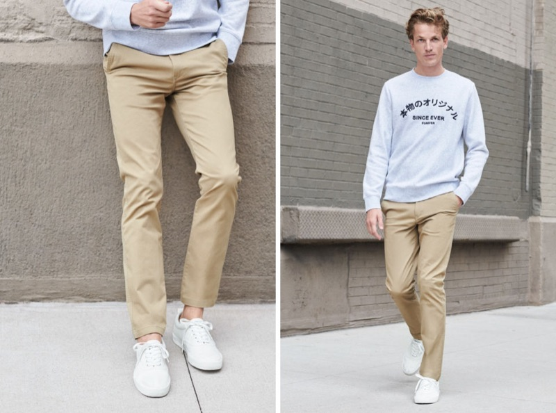 Making a case for classic casual style, Hugo Sauzay wears H&M's skinny chinos with a grey sweatshirt.