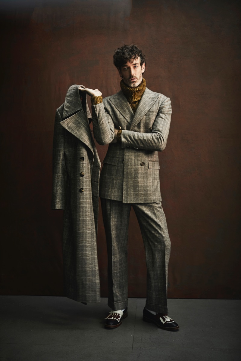 Richard Biedul dons an elegant double-breasted suit by Helen Anthony.