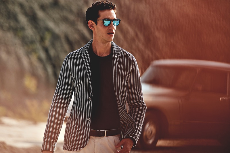Wearing a striped blazer, Andrey Smidl appears in L.B.M. 1911's spring-summer 2019 campaign.