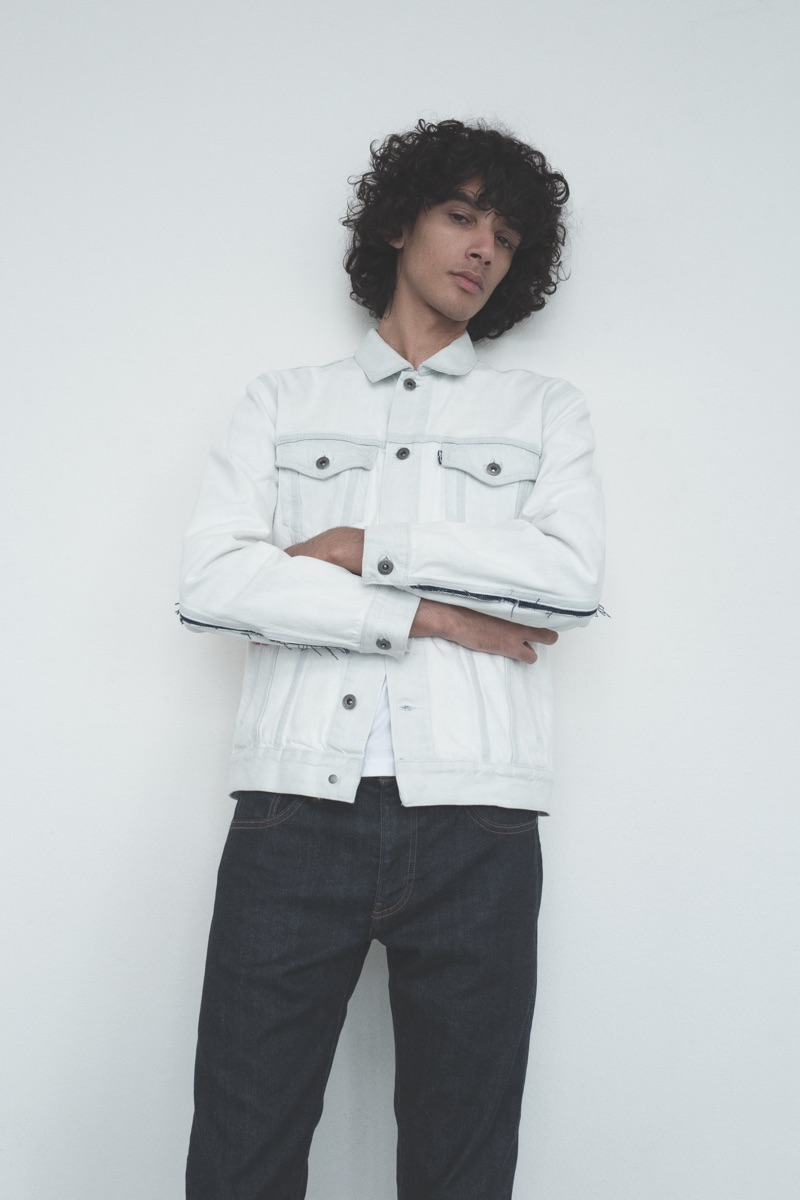 Front and center, Callum Stoddart sports a denim jacket and jeans from Levi's Made & Crafted.