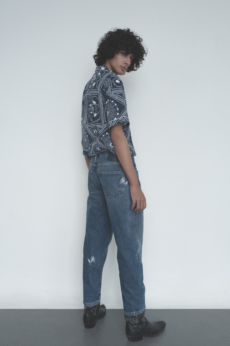 Sporting a bandana print shirt, Callum Stoddart wears Levi's Made & Crafted collection.