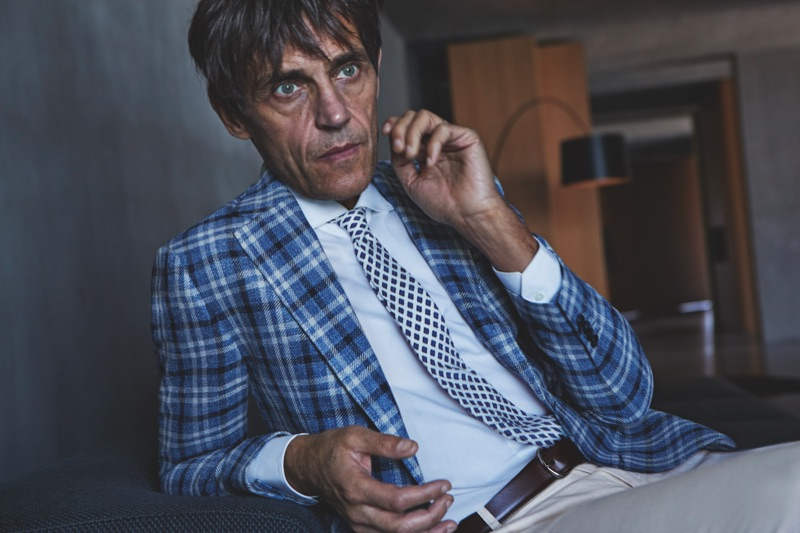 Didier Vinson dons a checked suit jacket by Luigi Bianchi Mantova.
