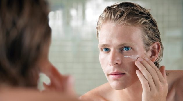 Man with Facial Cream in Mirror