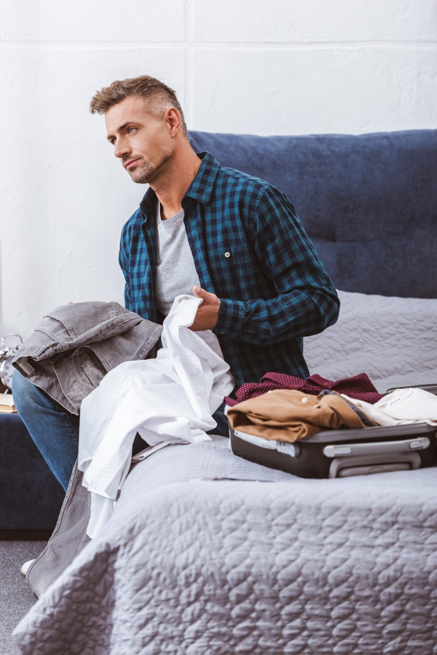 Man Organizing Clothes