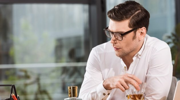 Man with Whiskey Looking Depressed Wearing Glasses