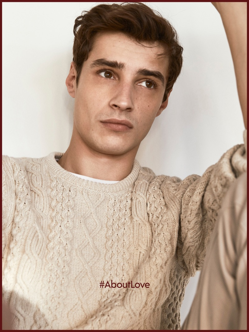 Adrien Sahores dons a cable-knit sweater by Massimo Dutti.