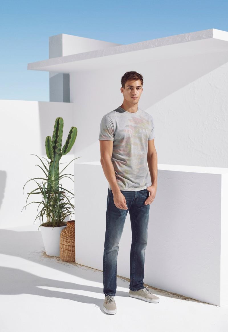 Alessio Pozzi rocks distressed denim jeans from Mavi's spring-summer 2019 lineup.