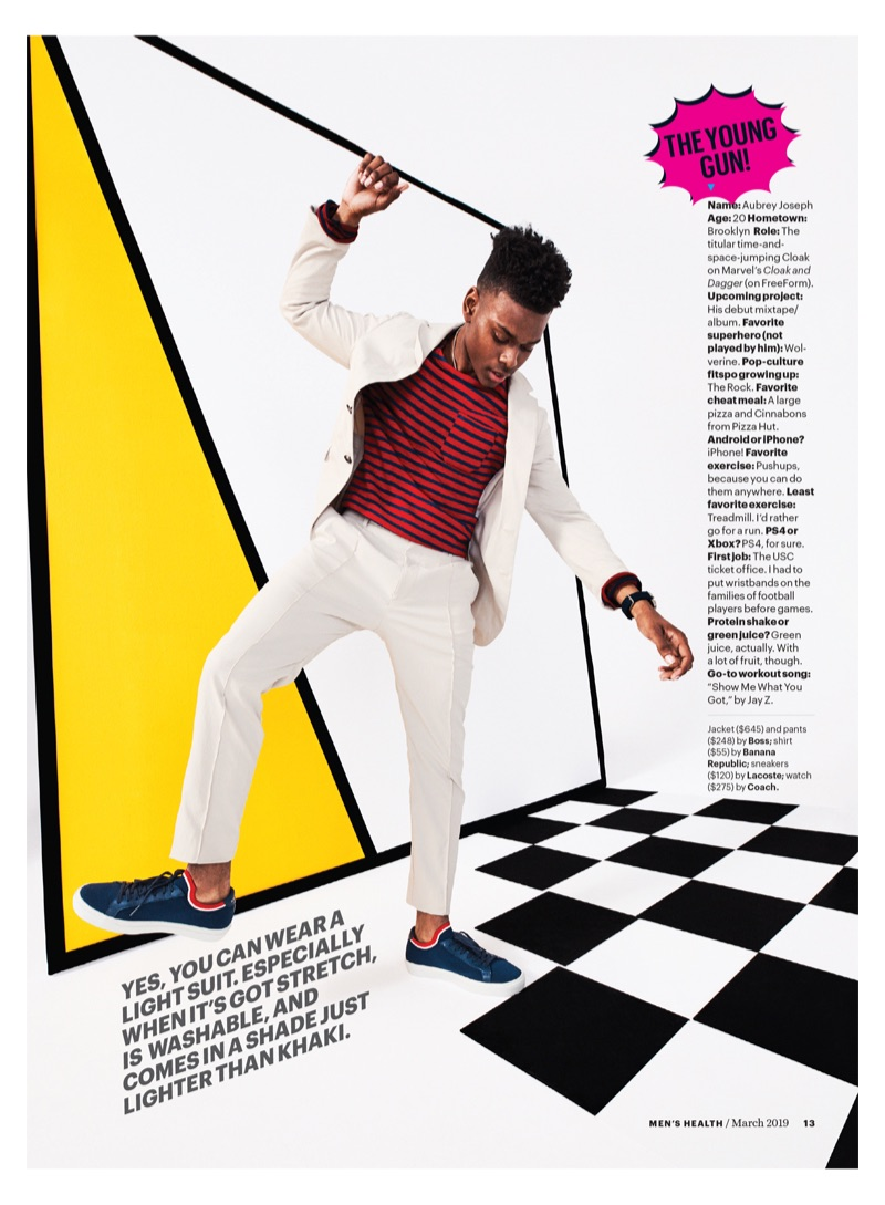 Rapper and actor Aubrey Joseph wears a BOSS suit, Banana Republic shirt, Lacoste sneakers, and Coach watch.