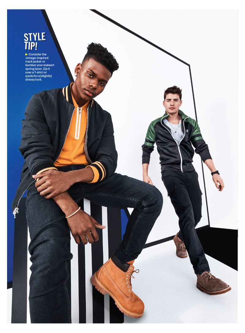 Left: Aubrey Joseph wears a Rag & Bone bomber jacket, Z Zegna polo, Calvin Klein Jeans denim, and Timberland boots. Gregg Sulkin rocks a Todd Snyder + Champion track jacket, Armani Exchange t-shirt, Michael Kors cargo pants, and Closed boots.