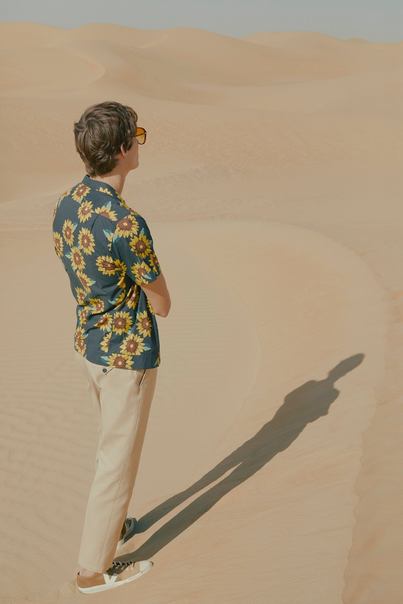Florals: Felix Gesnouin sports a Mr P. t-shirt with Burberry chinos, Brioni sunglasses, and Veja sneakers.