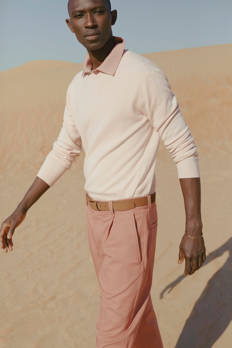 Pastels: Armando Cabral dons a pink cashmere sweater by Stella McCartney with Acne Studios trousers.