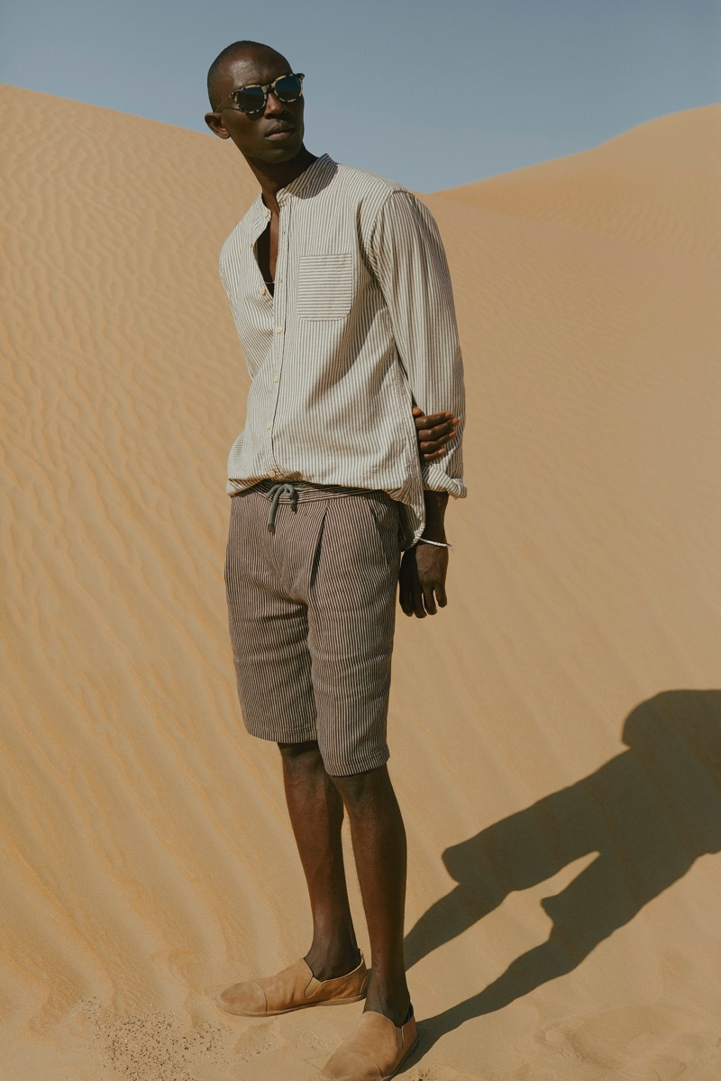 Pleats: Armando Cabral wears an Oliver Spencer grandad-collar striped shirt with Berluti + Oliver Peoples sunglasses.