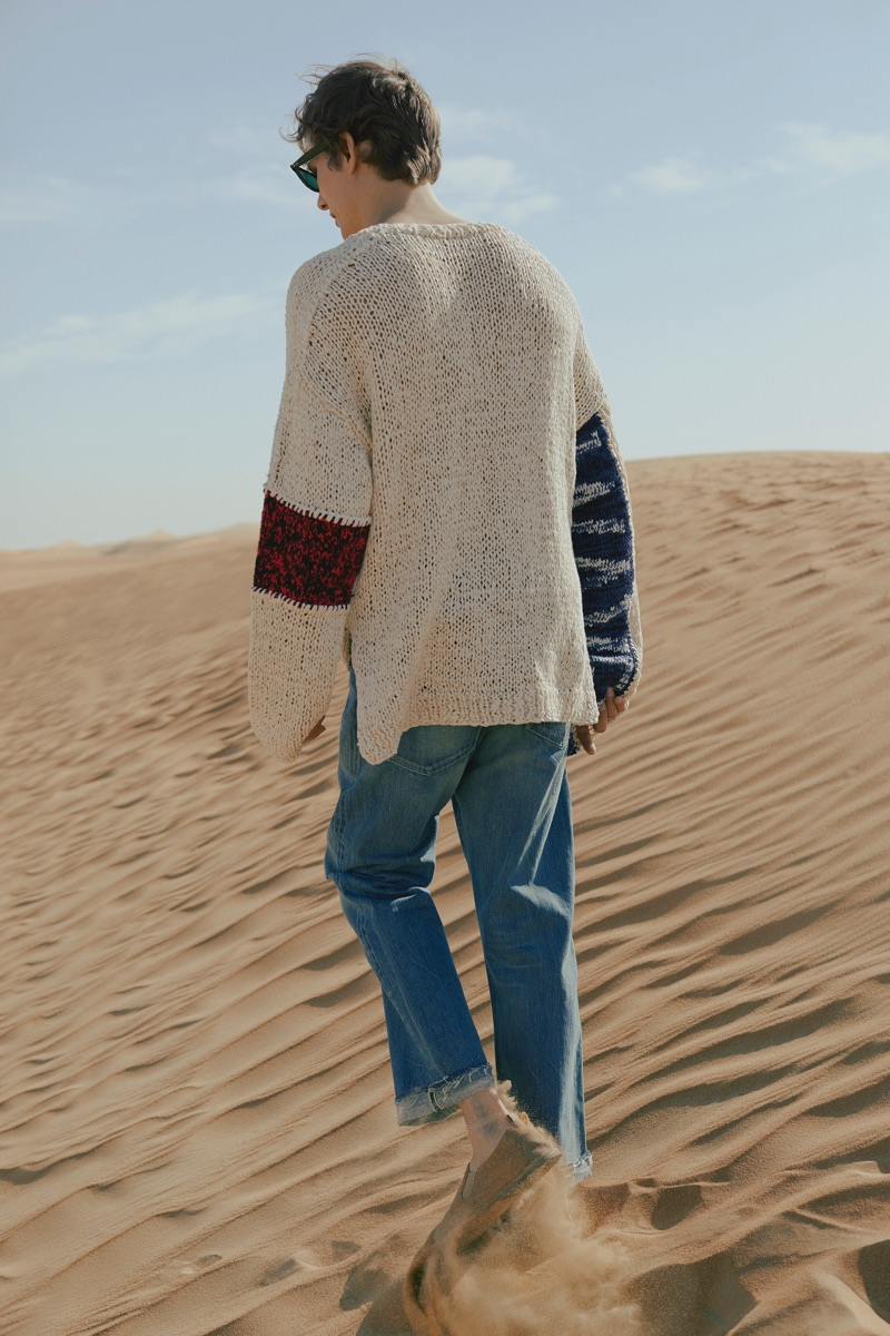 Summer Knitwear: Felix Gesnouin dons an Ambush oversized sweater with Chimala distressed jeans, Ray-Ban sunglasses and Marsell loafers.