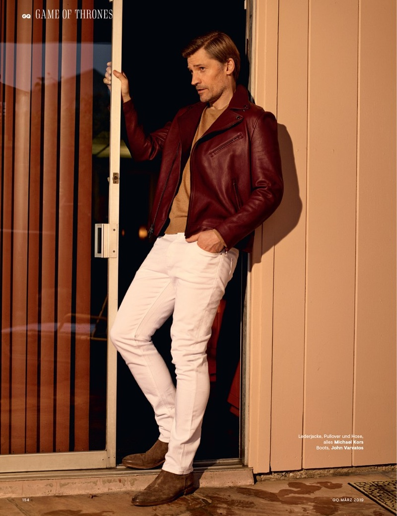 Actor Nikolaj Coster-Waldau dons a leather jacket, sweater, and jeans by Michael Kors with John Varvatos boots.