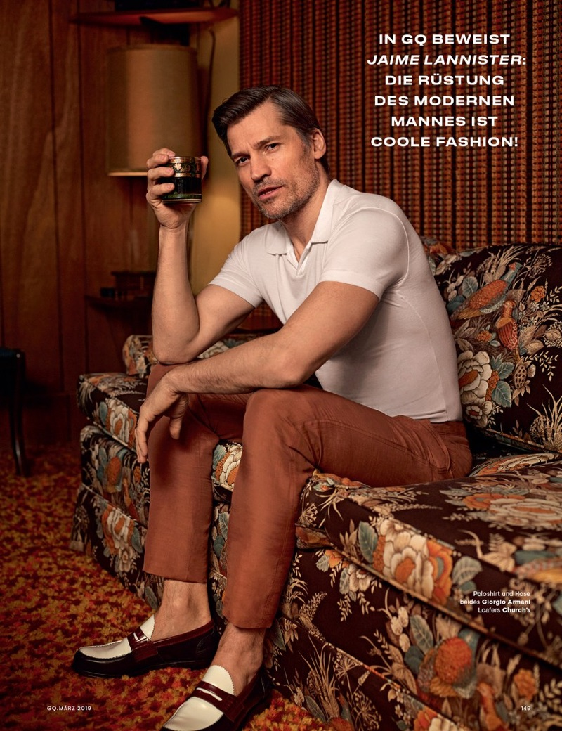 Starring in a new photo shoot, Nikolaj Coster-Waldau wears a Giorgio Armani polo and trousers with Church's loafers.