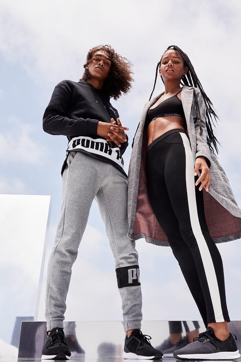 Models Leo Hoye-Egan and Selena Sloan go sporty in grey and black styles.