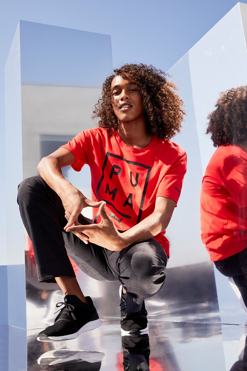 Rocking a red PUMA t-shirt, Leo Hoye-Egan connects with Nordstrom for a sporty outing.