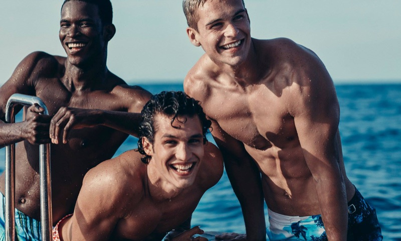 All smiles, Salomon Diaz, Francisco Henriques, and Mitchell Slaggert sport Orlebar Brown swimwear.