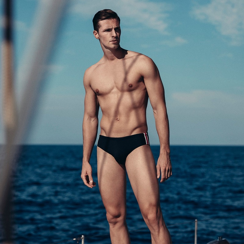 Edward Wilding models an Orlebar Brown swimsuit.