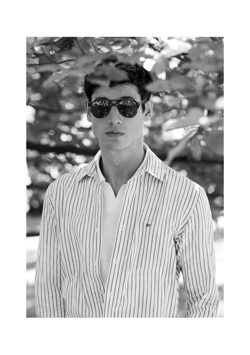 Connecting with Pedro del Hierro, Nicolas Ripoll wears a striped shirt.