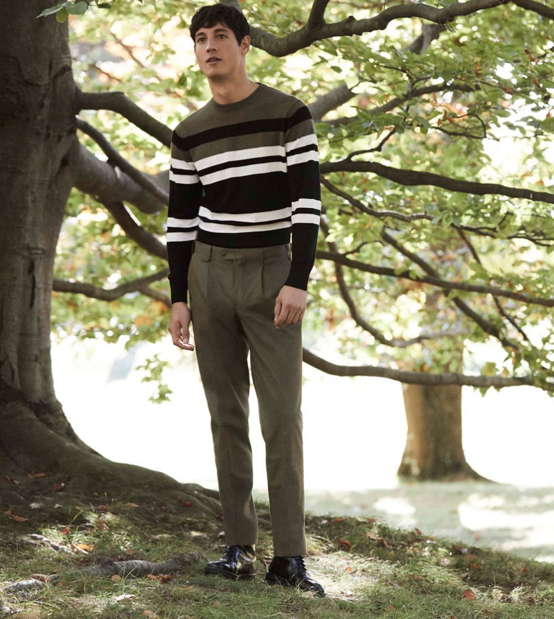 Argentinean model Nicolas Ripoll sports a striped sweater and trousers by Pedro del Hierro.