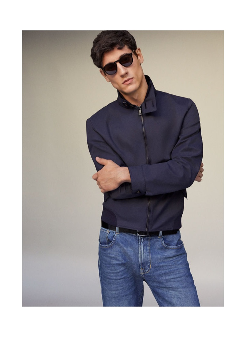 1257d9ec21758 Nicolas Ripoll sports denim jeans and a navy jacket by Pedro del Hierro.