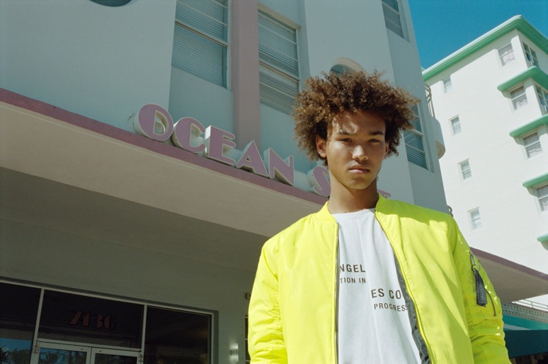 Standing out with a pop of color, Miles Anderson wears Pull & Bear.