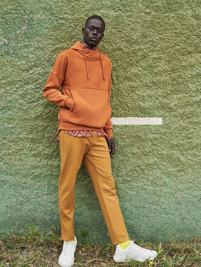 Sporting burnt orange, Alpha Dia sports an outfit by Reserved.