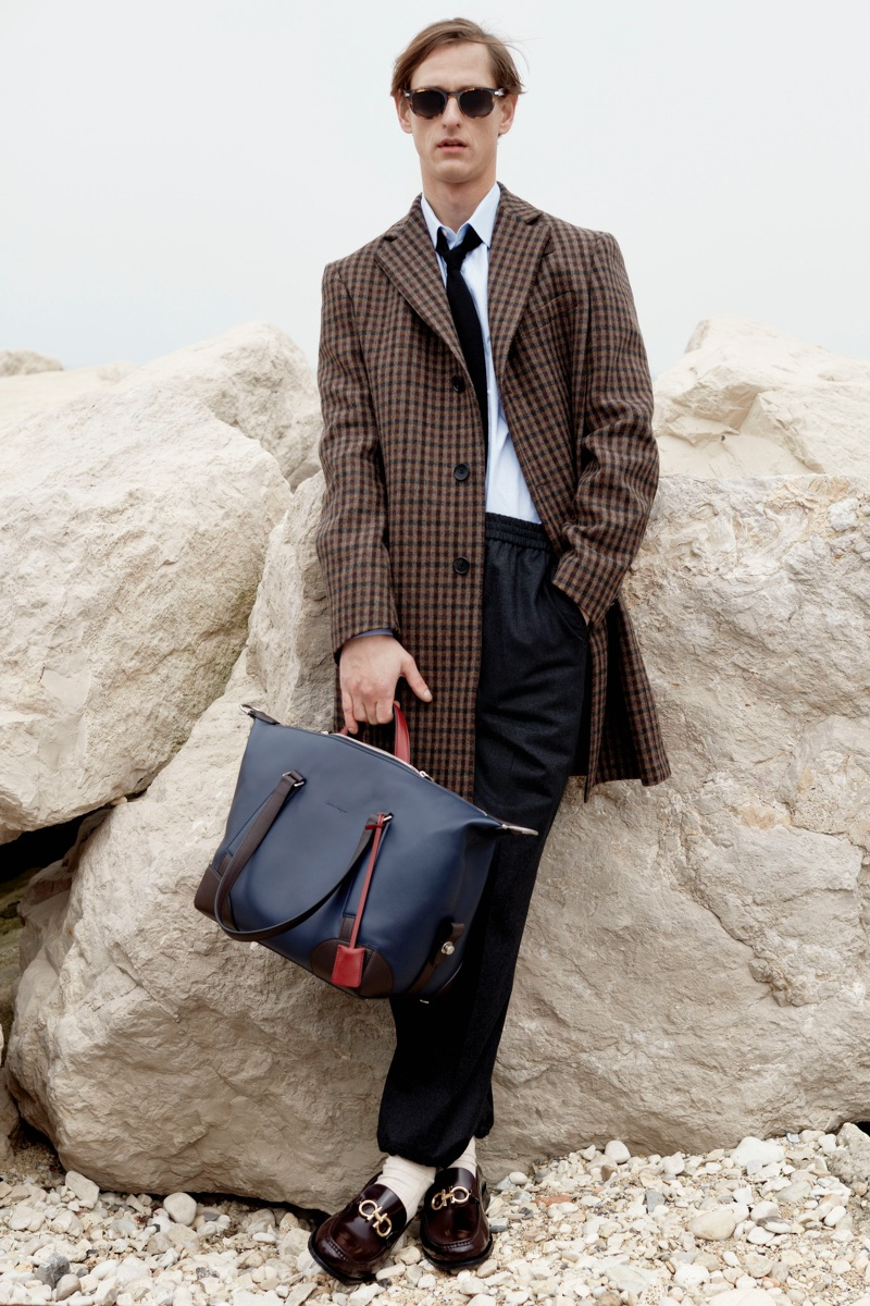 A chic vision, Rogier Bosschaart dons a checked coat from Salvatore Ferragamo.