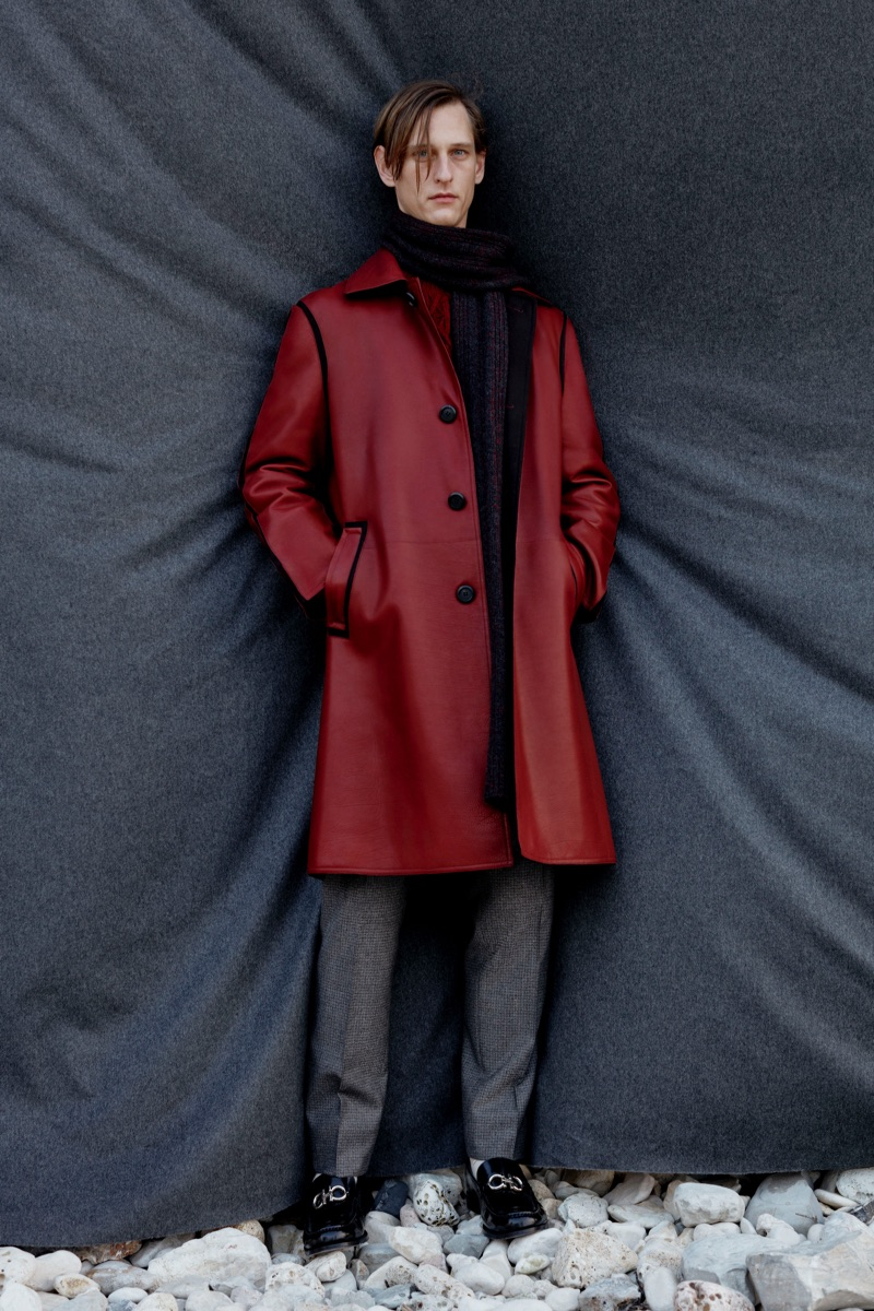 Standing out in a red coat, Rogier Bosschaart wears Salvatore Ferragamo.