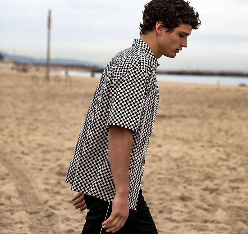 Taking to the beach, Simon Nessman fronts Sandro's spring-summer 2019 campaign.