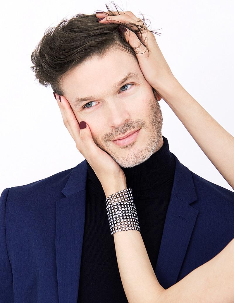 Scott wears turtleneck UNIQLO and suit jacket H&M.