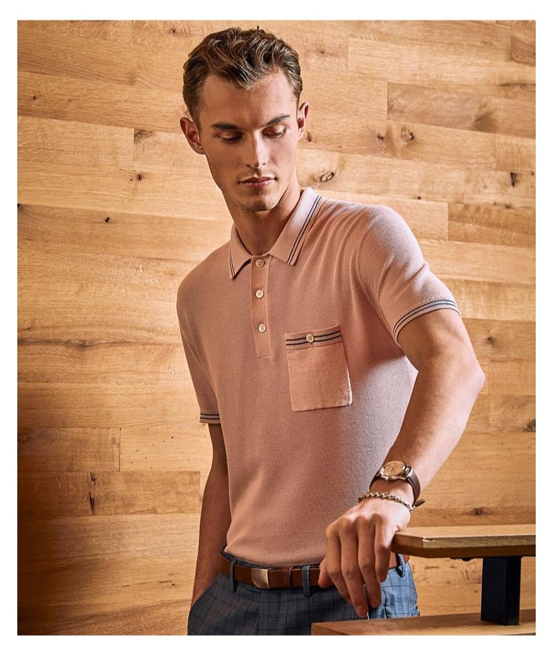 Kit Butler dons a pink tipped cotton silk micro mesh tipped polo by Todd Snyder.