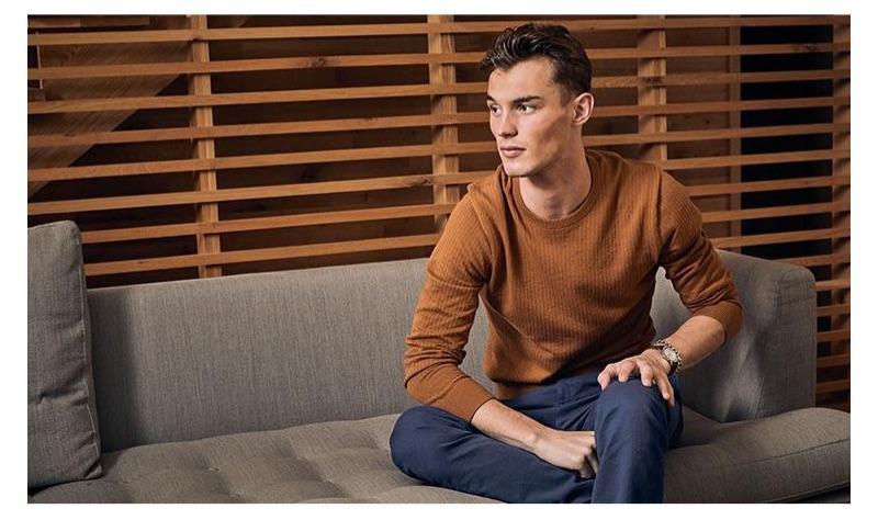 British model Kit Butler sports a mustard cotton crew neck.
