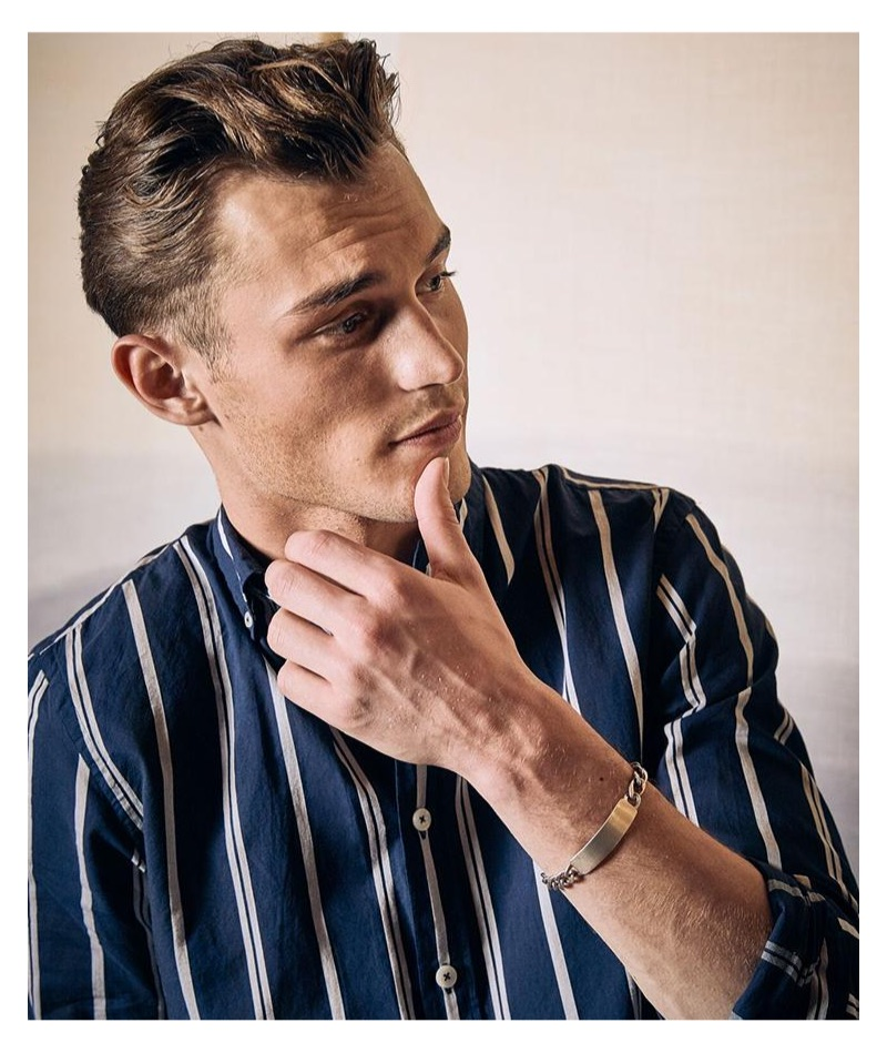 Making a case for stripes, Kit Butler models Todd Snyder's lightweight navy striped button-down shirt.