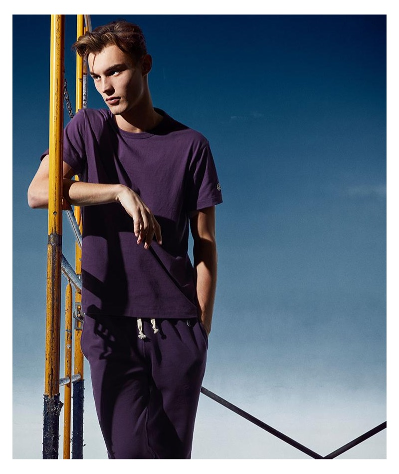 Dressed in purple, Kit Butler rocks a Todd Snyder + Champion tee and terry jogger sweatpants in plum.