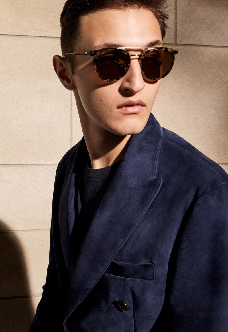 "Sporting sunglasses, Anwar Hadid is captured ""Backstage"" for Tod's spring-summer 2019 campaign."